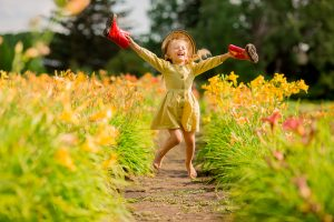 girl running through flowers in spring time
