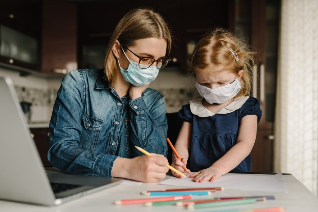Mom and daughter wearing protective mask in quarantine.